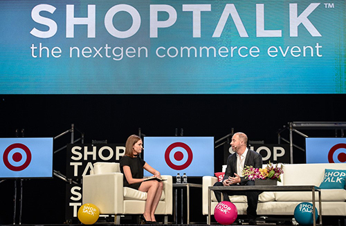 Casey and Hilary sitting onstage at a Shoptalk event