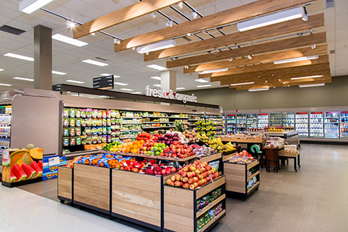 The produce section of our enhanced Grocery department, filled with fresh fruits and veggies.