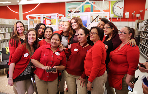 Meghan Trainor poses for a photo with a group of team members in a New Jersey Target store.