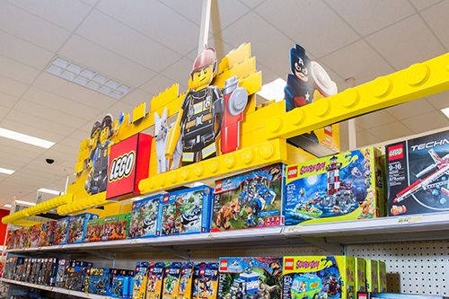 Closeup of the new yellow LEGO signage and products.