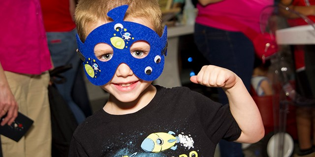 A child from St. Jude Children's Hospital in his martian mask created at the Bullseye's Bash event