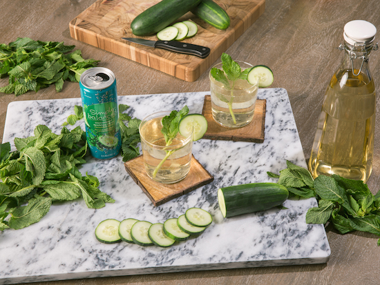 Cucumber Mint Simply Balanced sparkling water is pictured with the drink ingredients