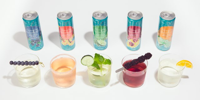 Cans of sparkling water are pictured behind each of the drinks