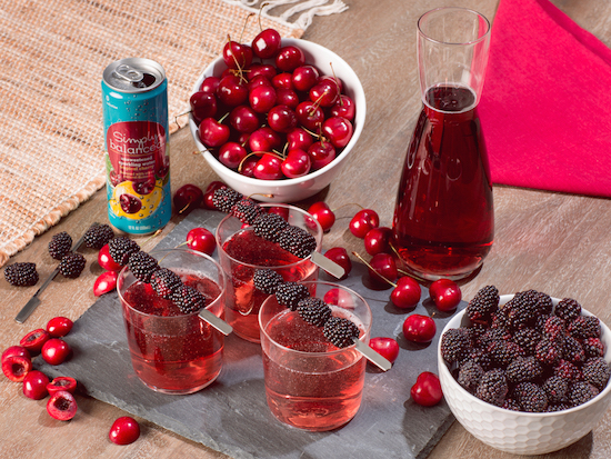 Tropical Cherry Simply Balanced sparkling water is pictured with the drink ingredients