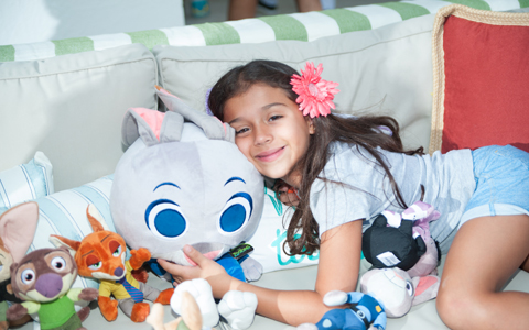 One of Barbara's girls poses with Zootopia plush toys