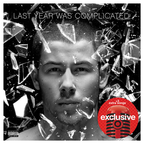Glass shatters around Nick Jonas on his album cover.