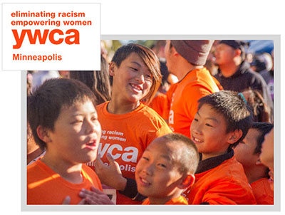 Kids in orange YWCA t-shirts playing together