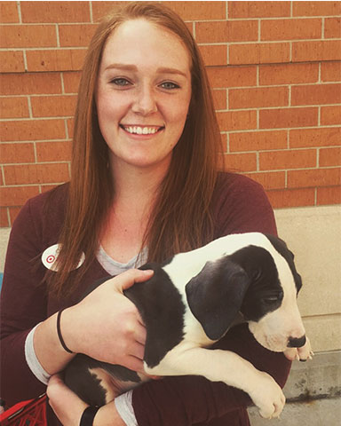 A photo of Caitlynn Davis holding a puppy