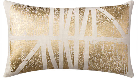 An offwhite, rectangular pillow with gold foil print