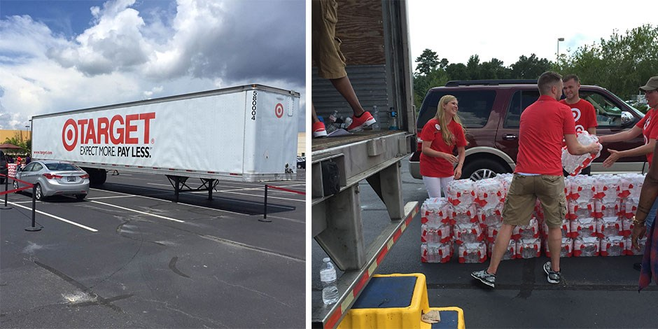 Team members distribute bottled water to flood victims in Louisiana