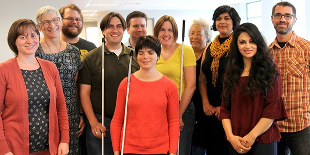 Eleven members of Target's Accessibility team standing together in a conference room