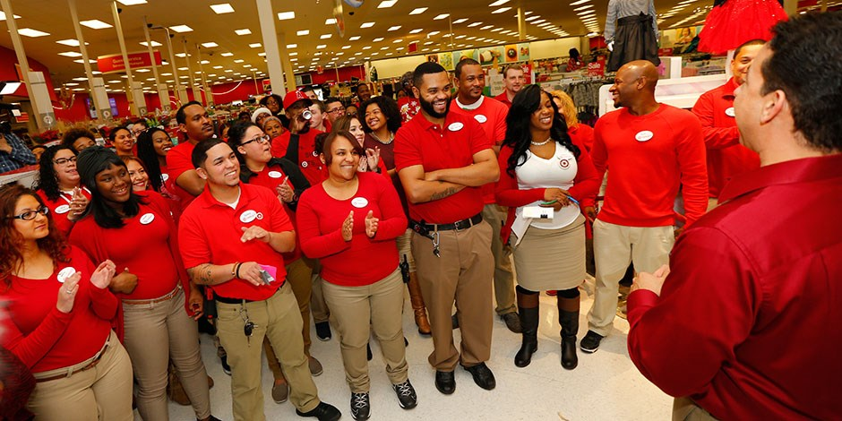 A group of team members gears up to open their store for the Black Friday shopping event.