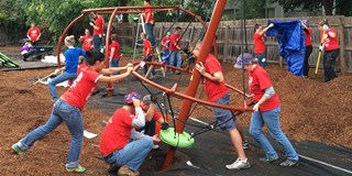 Target volunteers build a piece of playground equipment