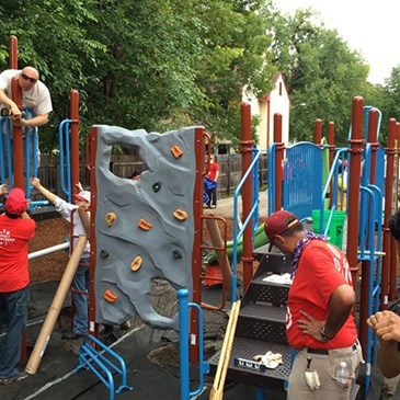 A group of volunteers build a jungle gym