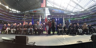 Target team members with Medal of Honor recipients at the welcome ceremony