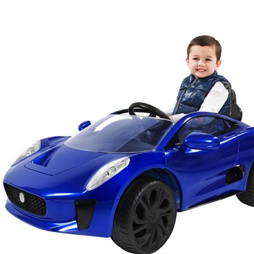 A little boy rides in the blue Jaguar Sports Car