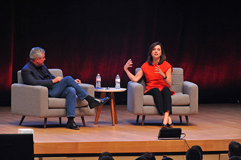 Mike McNamara and Beth Comstock sitting in seats onstage
