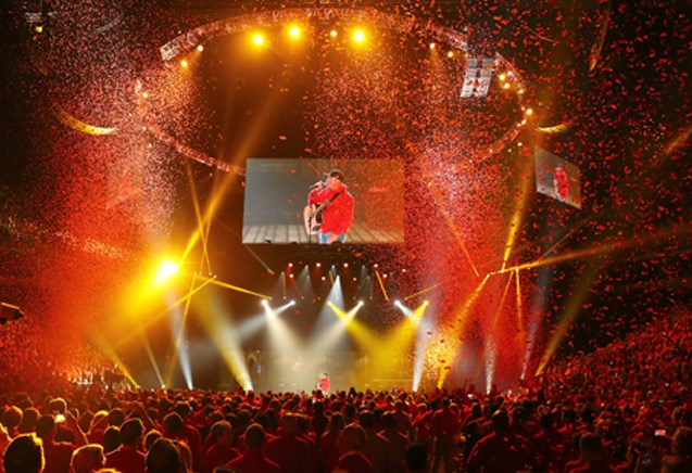 Garth Brooks performs for the Target team in a sea of red confetti.