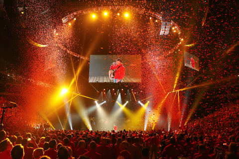 Garth Brooks performs for the Target team amidst a sea of red confetti.