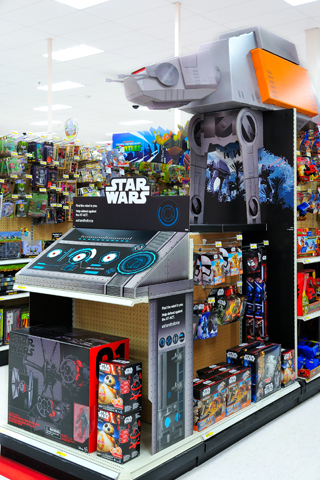 A giant grey and orange AT-ACT display in a toy aisle
