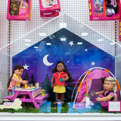 A camping vignette,  complete with picnic table, tent, three dolls and night sky scene