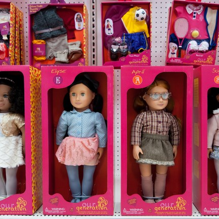 A close-up of two doll packages