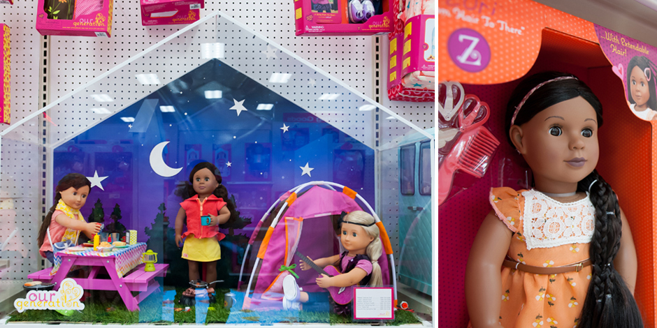An Our Generation display features three dolls and camping gear alongside a doll close-up