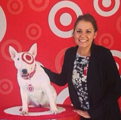 Head-and-shoulders shot of Katrina next to Bullseye the Target dog