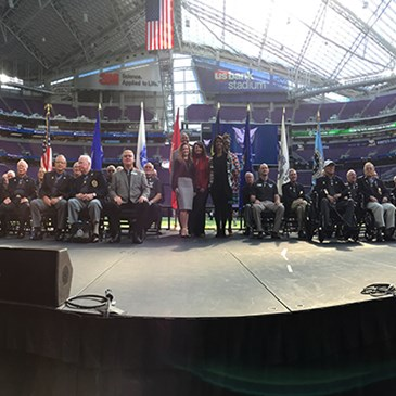 Target team members onstage at U.S. Bank Stadium with all of the Medal of Honor recipients