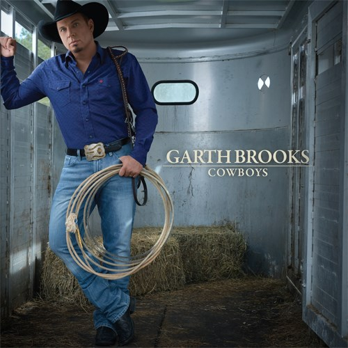 Garth, in jeans and a blue shirt, holds rope