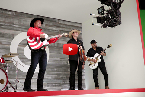 A behind-the-scenes photo of Garth and band recording video footage