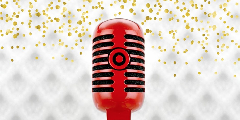 A red microphone against a white, glittery background