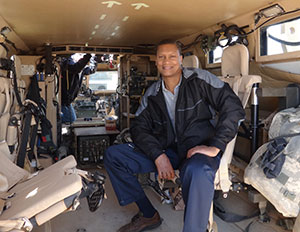 Marvin Hamilton sitting inside a military vehicle during his trip to Kuwait