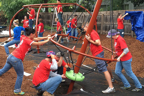 Target team members build a playground