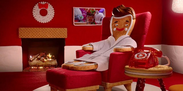 Deals icon Ginger Breadington sits at home in front of the fireplace