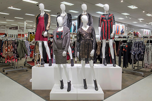 Women's apparel area with six mannequins in front