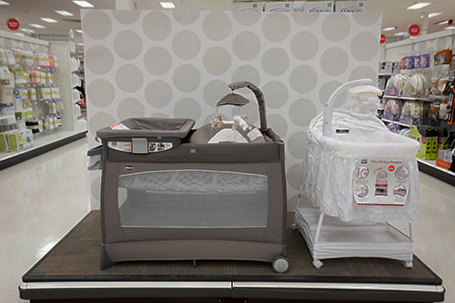 The Baby area with playpen and cradle on an endcap display