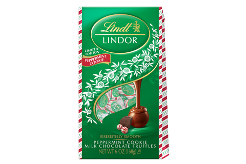 A green bag of Lindt truffles with candy cane edging