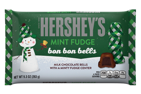 A snowman and chocolate bell on the cover of a green bag of Hershey's candy