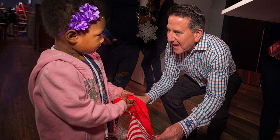 Target CEO Brian Cornell passes out gift bags to kids at the Bullseye's Bash event
