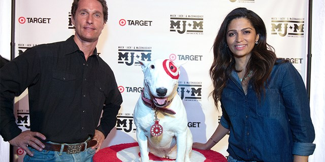 Matthew McConaughey and wife Camila Alves pose with Bullseye, the Target dog, at charity event