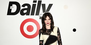 Supermodel Coco Rocha posing in front of The Daily Front Row x Target backdrop