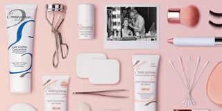 Embryolisse and other beauty products on pink background