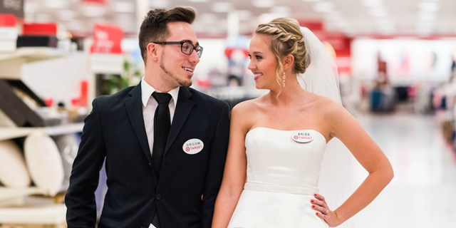 Lauren and Corey wearing bride and groom name tags at Target