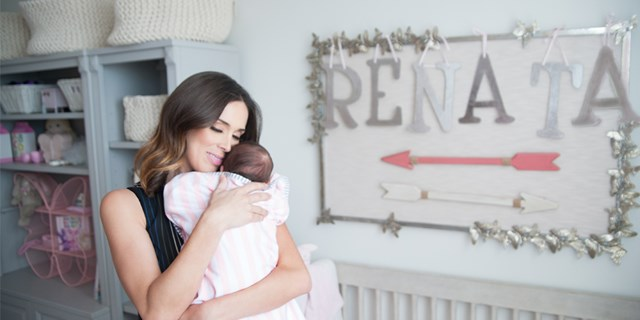Image of Jacky and her newborn daughter Renata in Renata's nursery
