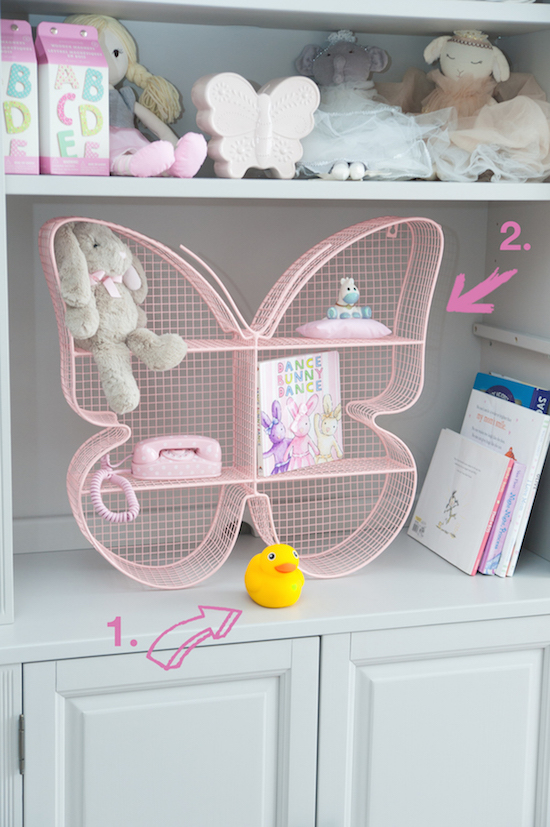 Pillowfort butterfly shelf and toy duck in Renata's smart nursery