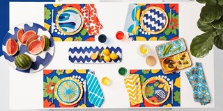 Aerial view styled shot of the Marimekko for Target entertaining sets laid out on a table