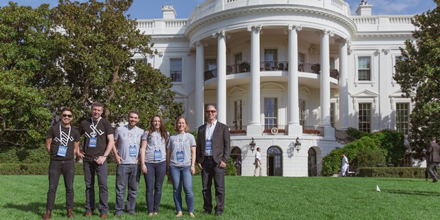 Casey Carl, Greg Shewmaker and team members in front of the White House