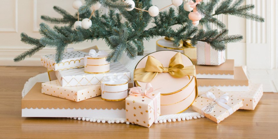 pink and gold sugar paper wrapped presents under a christmas tree