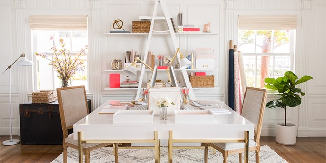 White room with sleek white and gold desk and shelves with pink gold and white Sugar Paper products